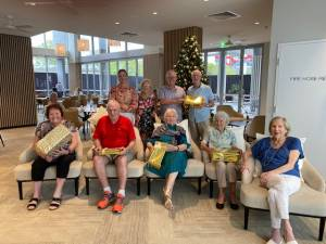 Image: Odyssey CEO Phil Usher with residents, supplied.